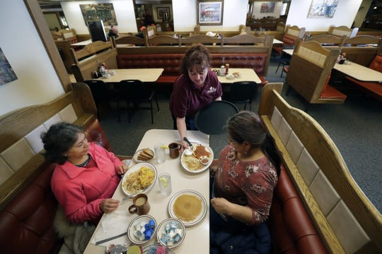 Shannon Lepinski serves breakfast to Blanca Arguirre, left, and Martha Franco, both of Appleton, at the new Maple Tree Restaurant & Pancake House in Appleton.