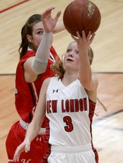 New London's Kate Christian puts up a shot against Macy McGlone of Hortonville during a game Feb. 28 in Kimberly.