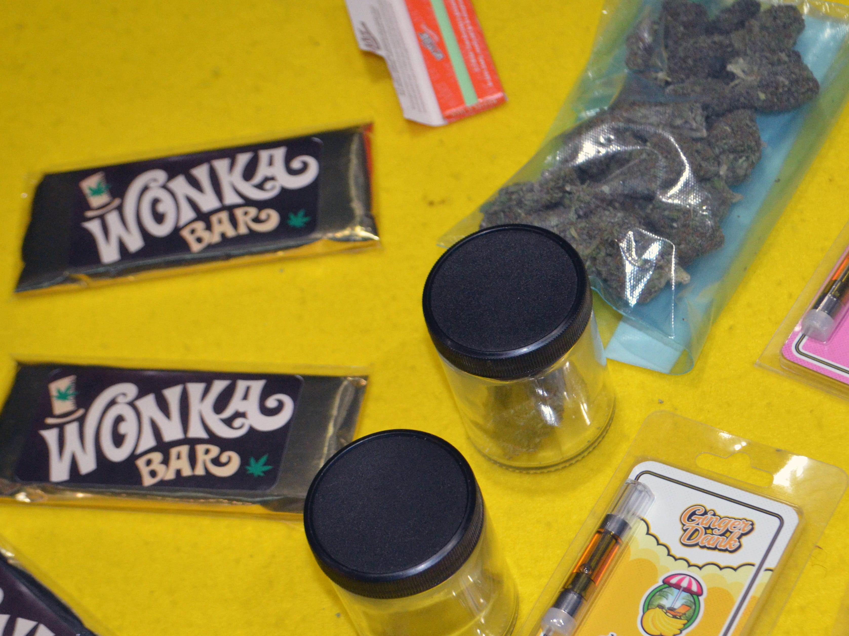 "Marijuana in various forms, including dried flower, edibles and concentrates, is displayed for sale at a black market ""pop-up"" event."