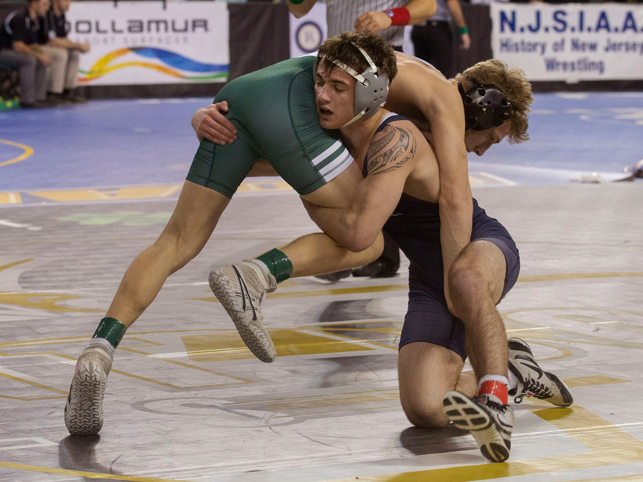 Howell's Darby Diedrich defeated Delbarton's Andrew Troczynski 3-1 in overtime during their 139 lbs bout. NJSIAA State Wrestling opening rounds in Atlantic City, Thursday February 28, 2019