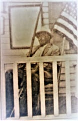 Sgt. George Ashby, photographed late in life sitting on an Allentown porch with a rifle. Courtesy Monmouth County Historical Commission.
