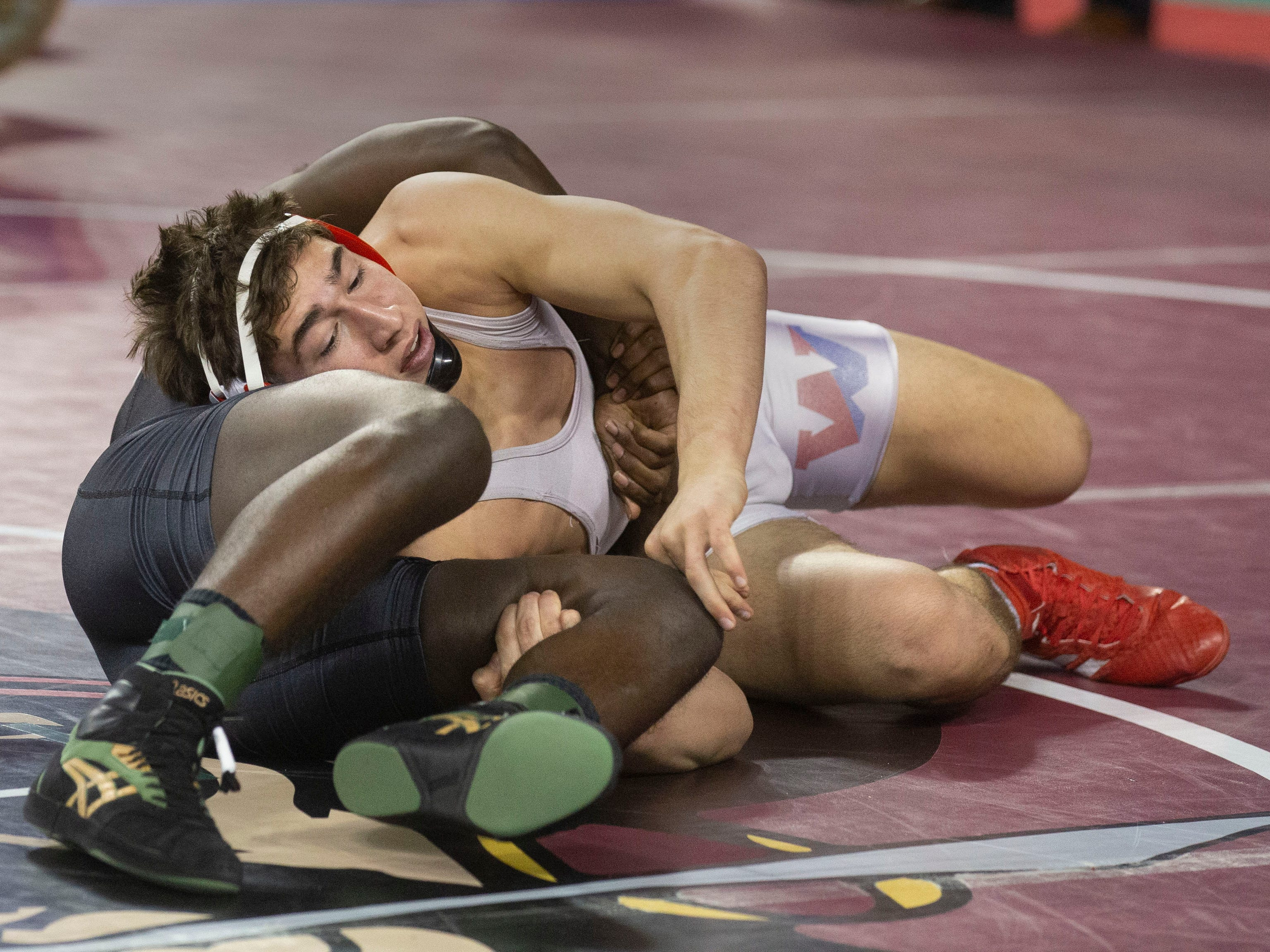Wall's Rob Kanniard defeated Pemberton's Joseph Wilson 12-2 in their 160 lbs. bout. NJSIAA State Wrestling opening rounds in Atlantic City, Thursday February 28, 2019