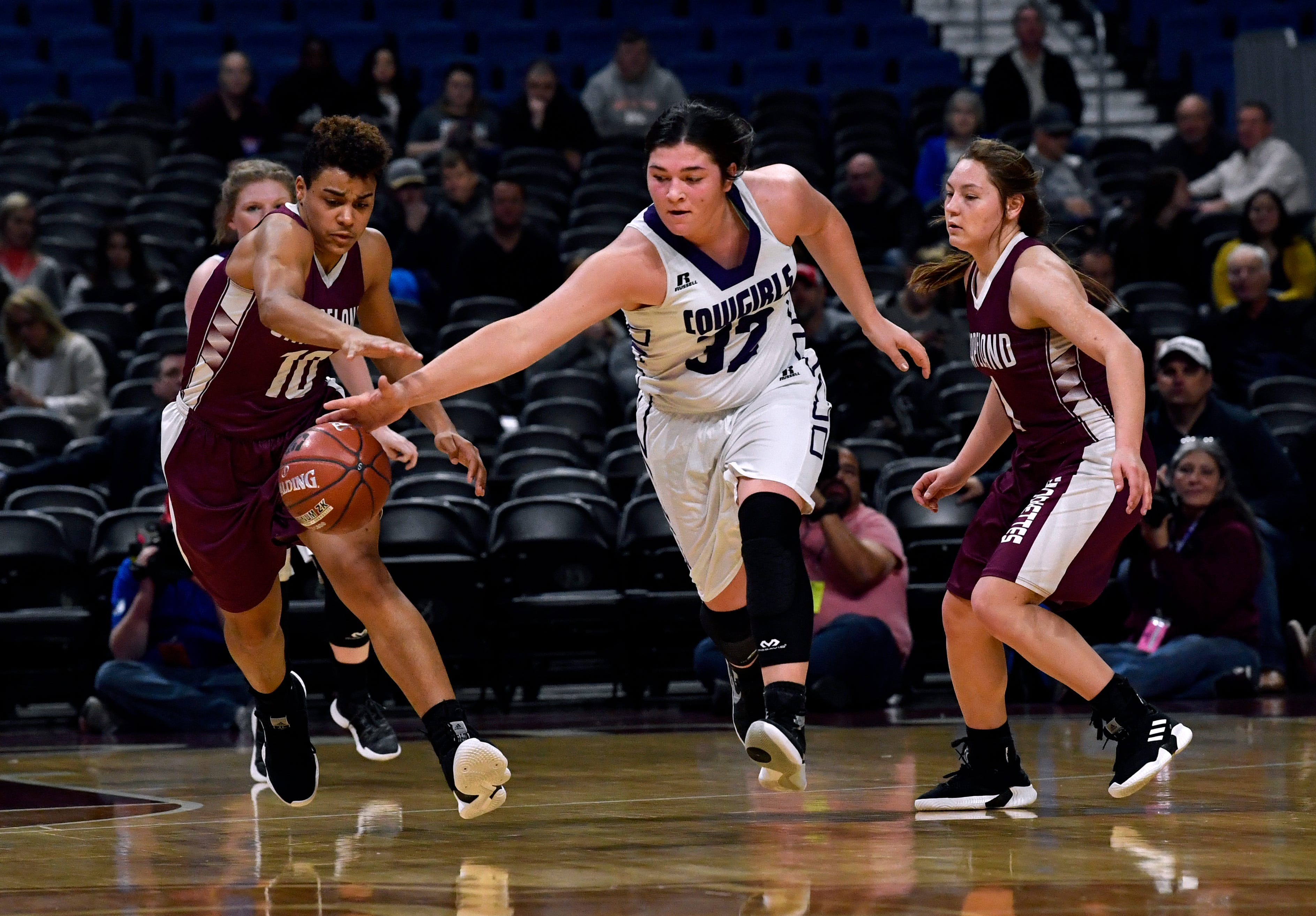 Cowgirls center Ruby Magnus tries to keep the ball away from Grapeland forward Teira Jones during Friday's UIL Class 2A girls state basketball semifinal at the Alamodome in San Antonio March 1, 2019.