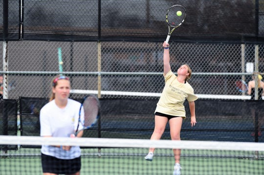Abilene High's Rachel Tebow serves behind girls doubles partner Lauren Schaeffer during a tournament earlier this spring. Tebow and Schaeffer have played together for four years and are heading to their third region tournament starting Wednesday in Arlington.