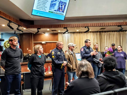 During the Abilene City Council meeting Thursday, Fire Chief Cande Flores gives Valor Awards to four people who helped save victims in a fiery bus crash Feb. 15. Honored were, from left, Josh Williams, Kelly Russell, Scottie Smith and Chance Angley. Also present were Kailey Smith, who was the bus driver that day, and Alexandria Seigler, a student who was on the bus, and her mother, Jennifer McFadden.