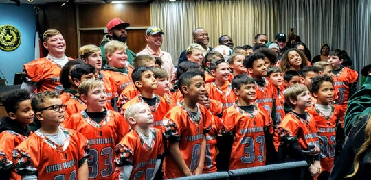Members of the Abilene Hurricanes pose with Mayor Anthony Williams during the Abilene City Council meeting on Thursday.
