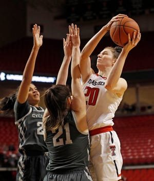 Former Texas Tech standout Brittany Brewer, right, has joined the Abilene Christian women's basketball staff as an assistant.