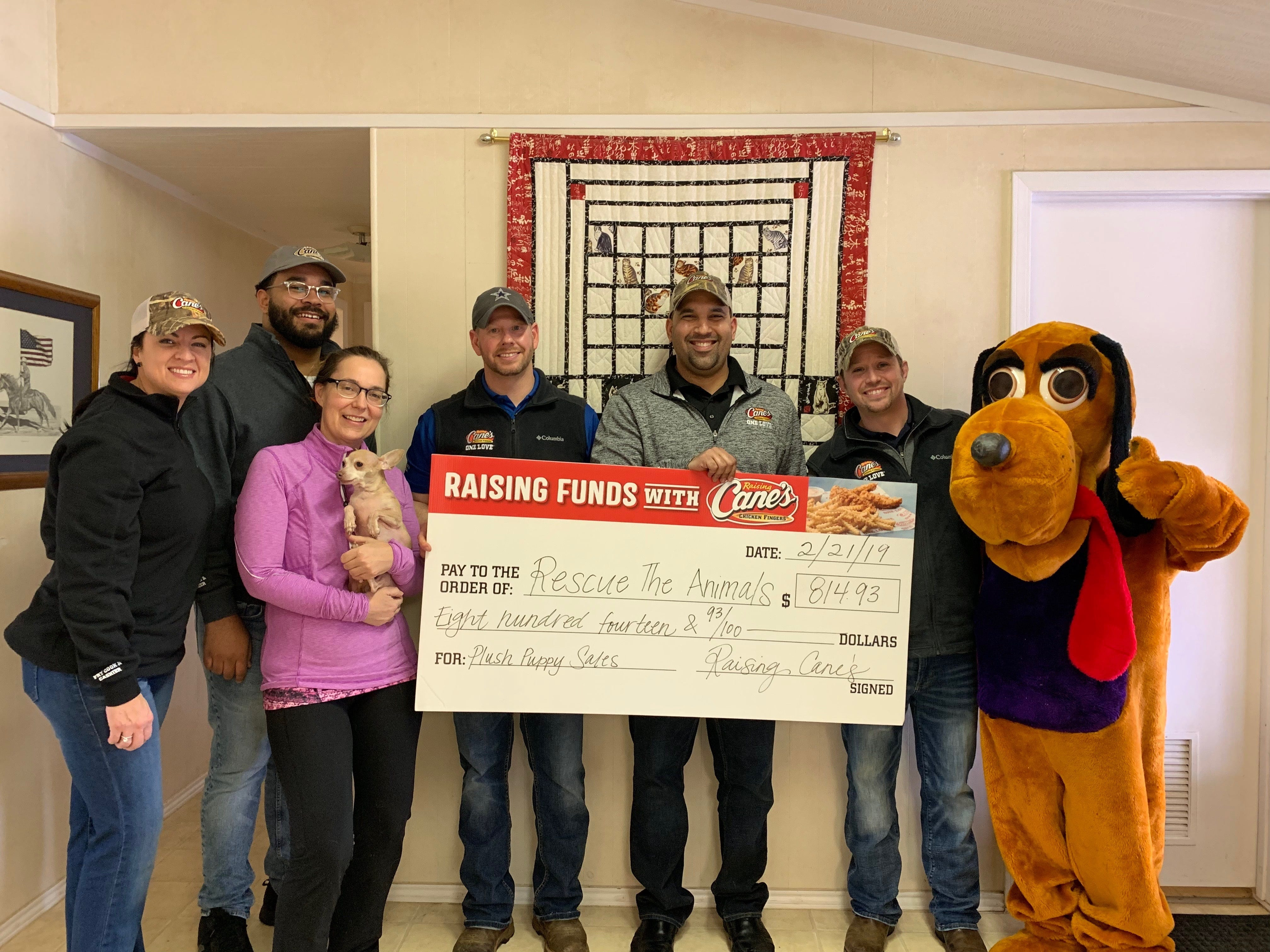 Raising Cane's recently donated $814.93 to Rescue the Animals, SPCA, as part of the restaurant chain's annual plush puppy and calendar fundraiser for pet welfare organizations. From left: Shawnon Bellah, Mike Spano, Cory Boyd, Ricky Merced, James Montgomery and Kathy Leonard.