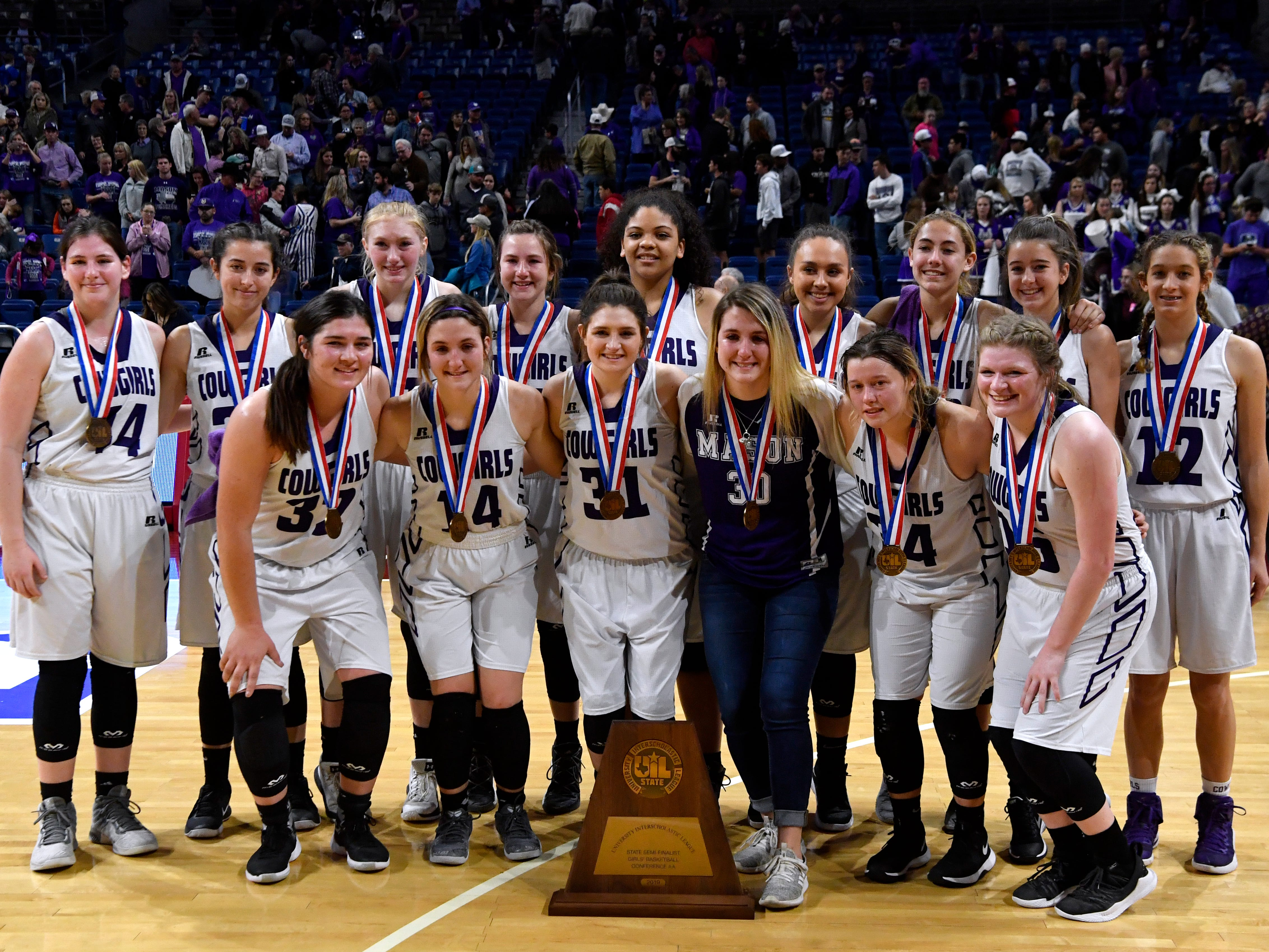 The Mason Cowgirls pose for a group photo with their Class 2A semifinal trophy Friday March 1, 2019 in San Antonio's Alamodome. The Cowgirls lost to the Grapeland Sandies, 61-54