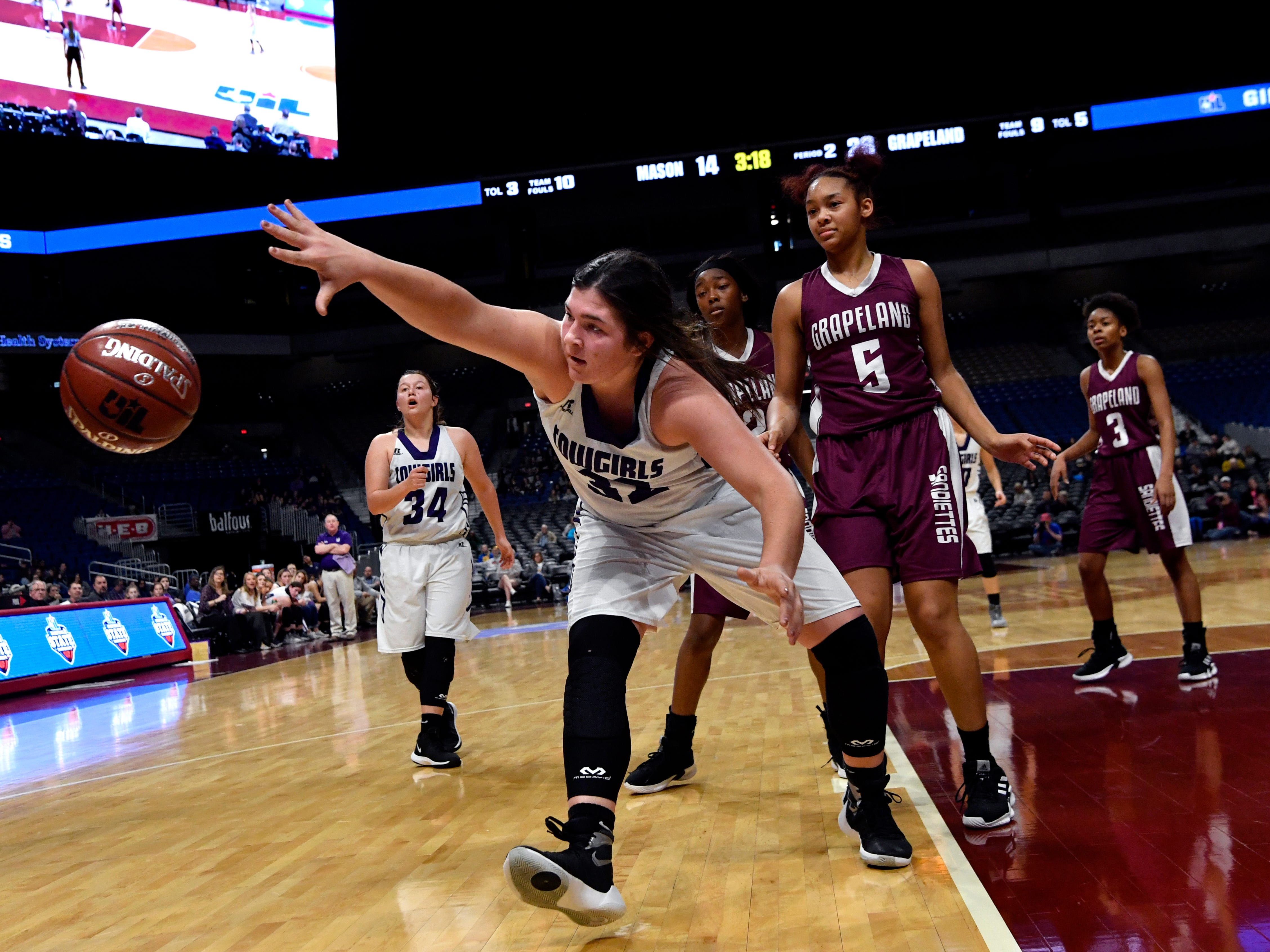 Mason center Ruby Magnus reaches for the ball after getting fouled by Grapeland during Friday's UIL Class 2A girls state basketball semifinal at the Alamodome in San Antonio March 1, 2019.