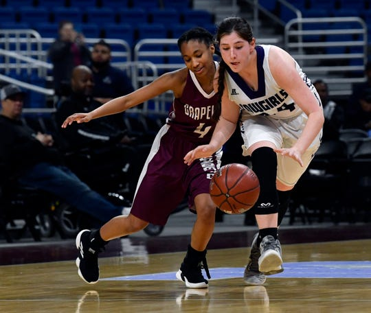 Mason forward McKenzie Cano fends off Grapeland guard Ragan Bowie as she takes the ball downcourt during Friday's UIL Class 2A girls state basketball semifinal at the Alamodome in San Antonio March 1, 2019.