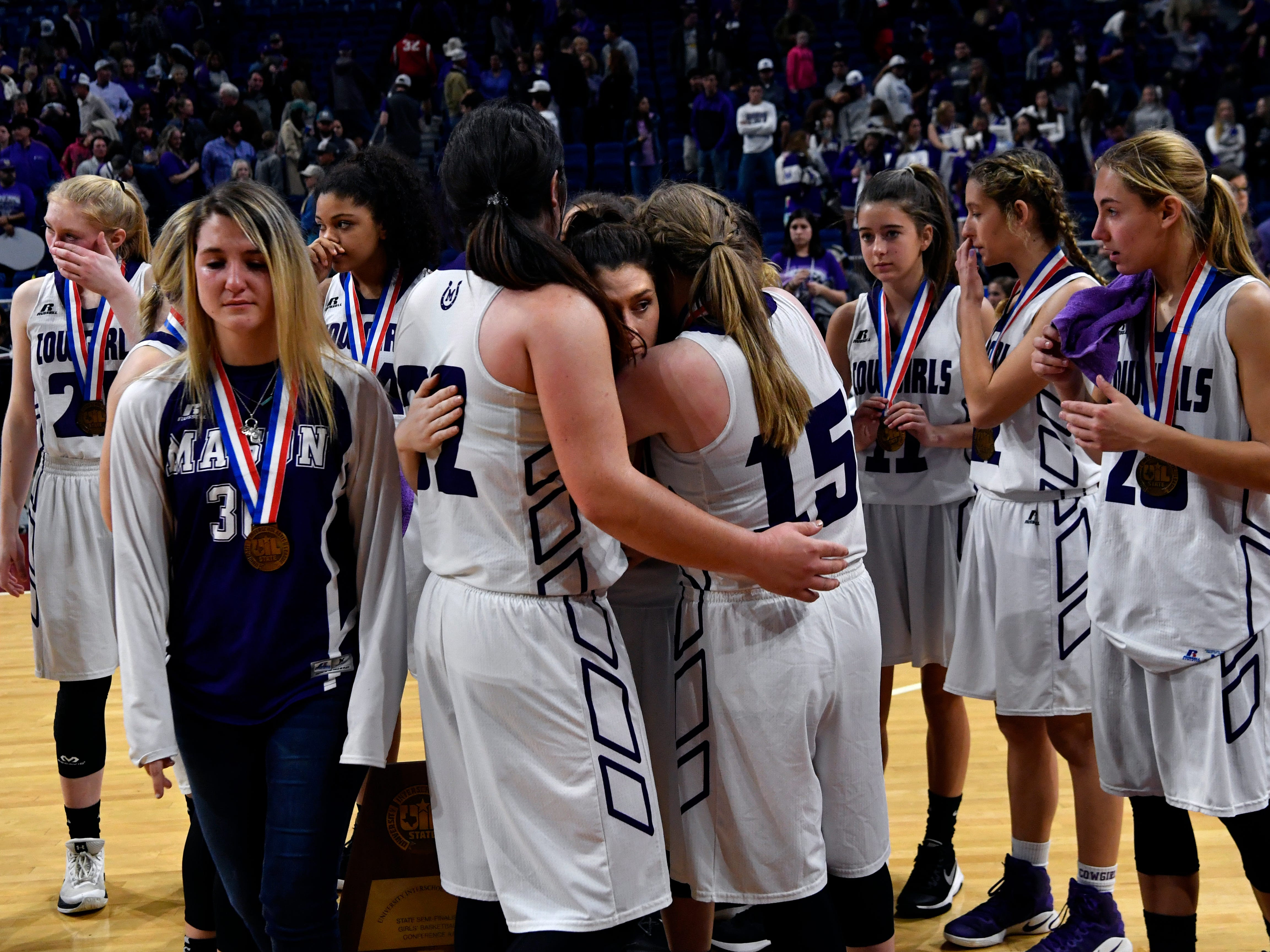 The Mason Cowgirls console each other after losing to Grapeland in Friday's UIL Class 2A girls state basketball semifinal at San Antonio's Alamodome March 1, 2019. Final score was 61-54, Grapeland.