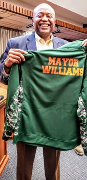 """Mayor Anthony Williams poses with a special sweatshirt given to him by members of the Abilene Hurricanes youth football team. During the Abilene City Council meeting Thursday, Williams issued a proclamation declaring Saturday and Sunday """"Abilene Hurricane Days."""""""