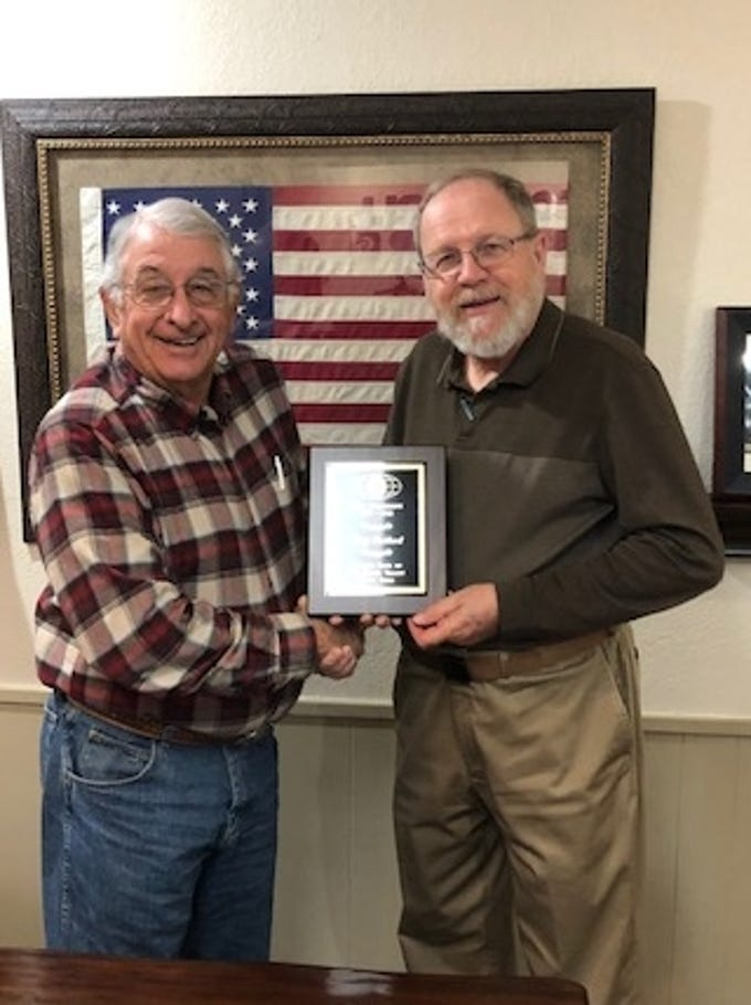 Don Holland, president elect of the Pecan Valley Kiwanis Club, presents the Past President's Plaque to Gary Twiford at the club's annual Sweethearts Awards Banquet on Feb. 15.