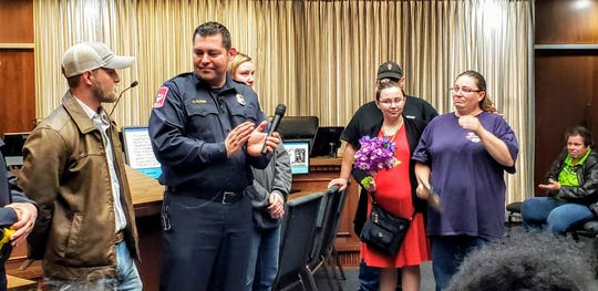 During the Abilene City Council meeting on Thursday, Jennifer McFadden thanks those who helped save her daughter, Alexandria Seigler, in the aftermath a bus accident Feb. 15. Fire Chief Cande Flores, second from left, is pictured next to Chance Angley, left, one of the people who helped that day, and bus driver Kayli Smith.