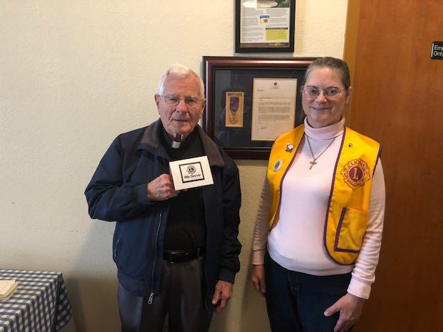 Guest speaker Rev. Monsignor Bernard Gully, of Sacred Heart Parish, meets with Abilene Founders Lions Club president Denise Wolfe at the club's Feb. 21 meeting.