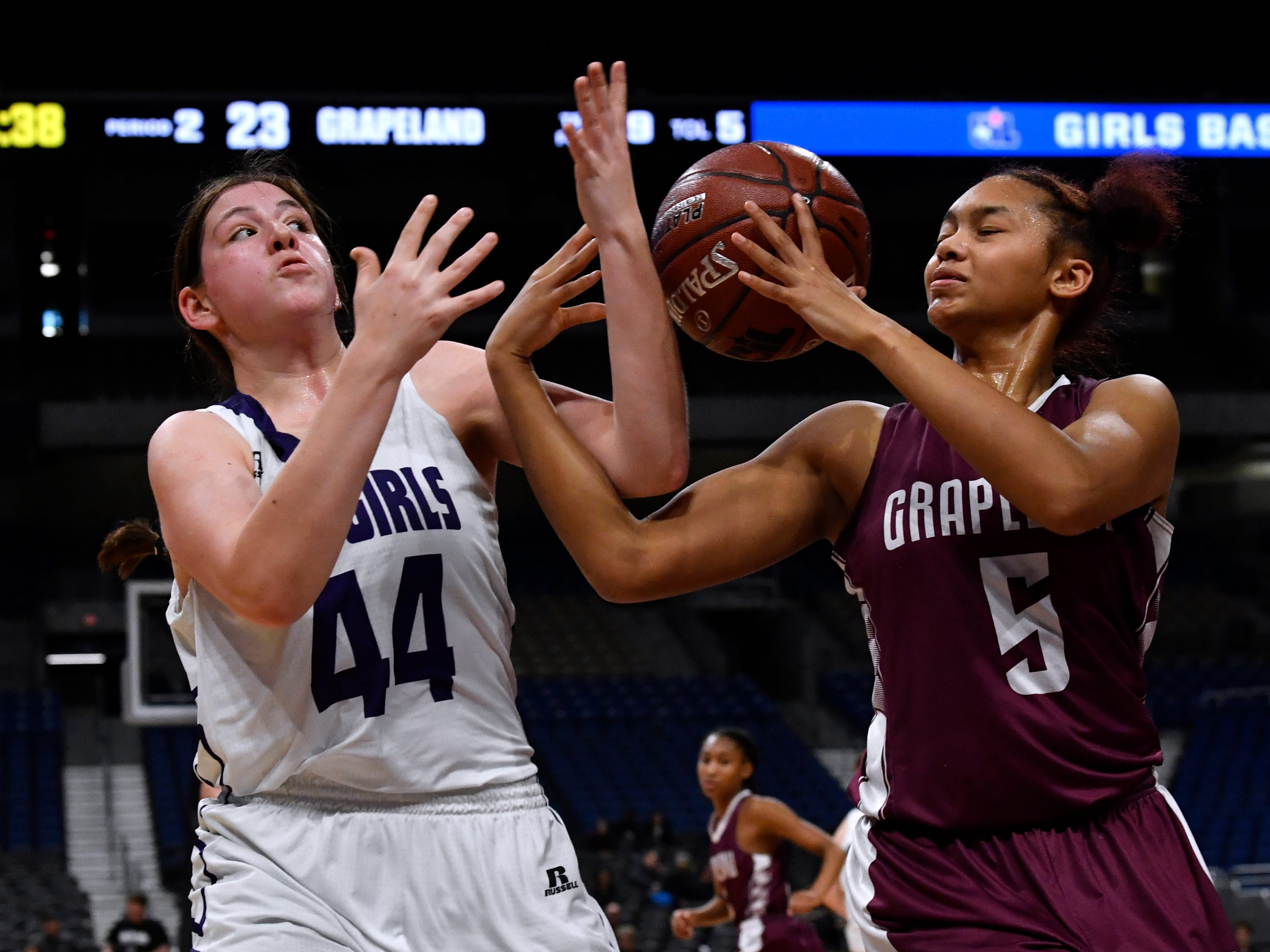 Mason forward McKenzie Cano (left) and Grapeland forward Ragan Bowie fumble for the ball after it bounced from the rim during Friday's UIL Class 2A girls state basketball semifinal at the Alamodome in San Antonio March 1, 2019.