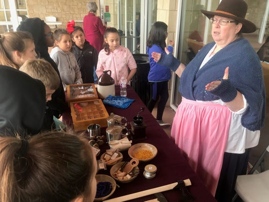 """Jere Madison, right, a volunteer at Frontier Texas!, discusses frontier life with students in Shannon Bell's fourth-grade class of Stamford Elementary School Friday. The Abilene museum celebrated Texas Independence Day early this year, as the day falls on Saturday in 2019. For the actual day, Frontier Texas! Executive Director Jeff Salmon said the museum is promoting a """"Toast to Texas Independence"""" at 6:36 p.m. where everyone pause and raise a drink in honor of its independence."""