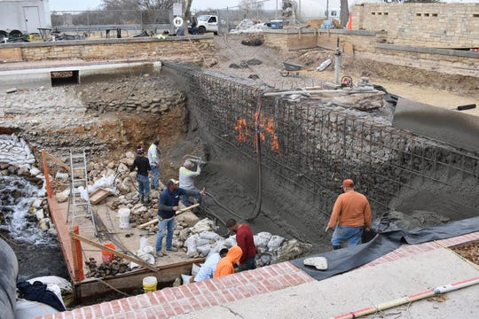 Photo from December 2018 shows contractors spraying and forming the concrete wall where steel reinforcing bar was placed in the pool at Balmorhea State Park.