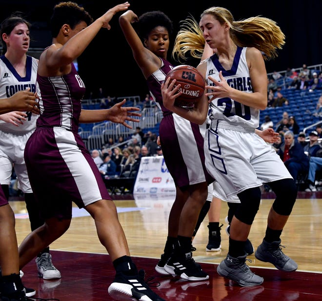 Mason guard Tristin Keller tries keeping the ball away from the Grapeland players after a failed basket attempt during Friday's UIL Class 2A girls state basketball semifinal at the Alamodome in San Antonio March 1, 2019.