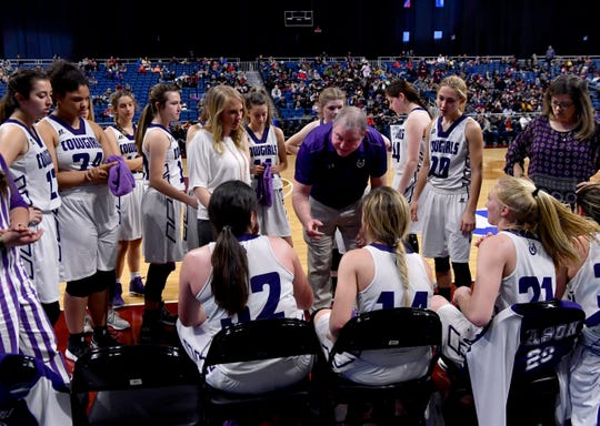 Mason head coach Jeff Guice speaks to his team between quarters during Friday's UIL Class 2A girls state basketball semifinal against Grapeland at the Alamodome in San Antonio March 1, 2019.