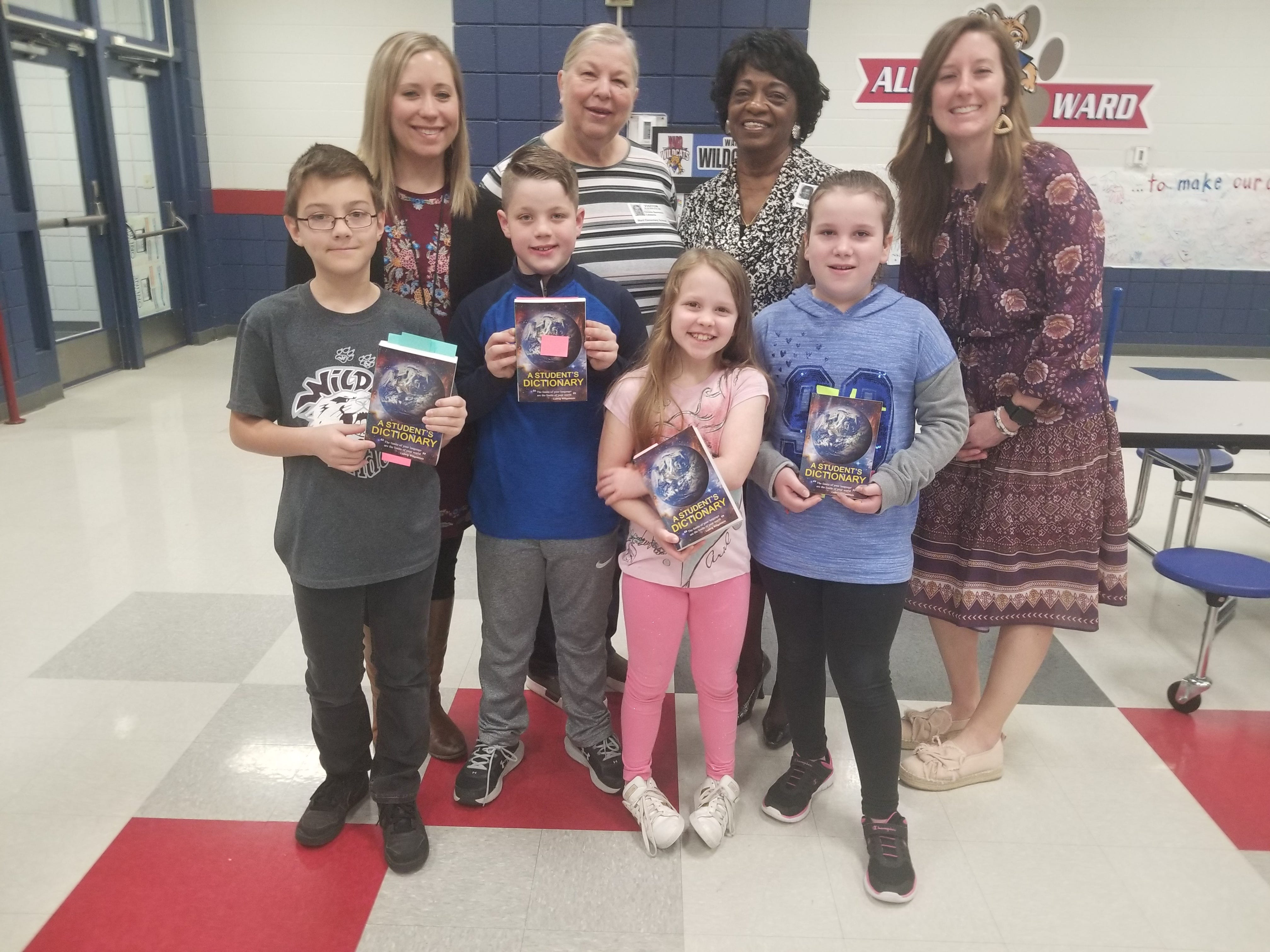 Members of Altrusa International of Abilene recently presented dictionaries to students at Ward Elementary School. Top row, from left: teacher Kaitlin Hoermann, Altrusans Christie Beermann and Dorothy Drones, and teacher Shelly Muzechenko.
