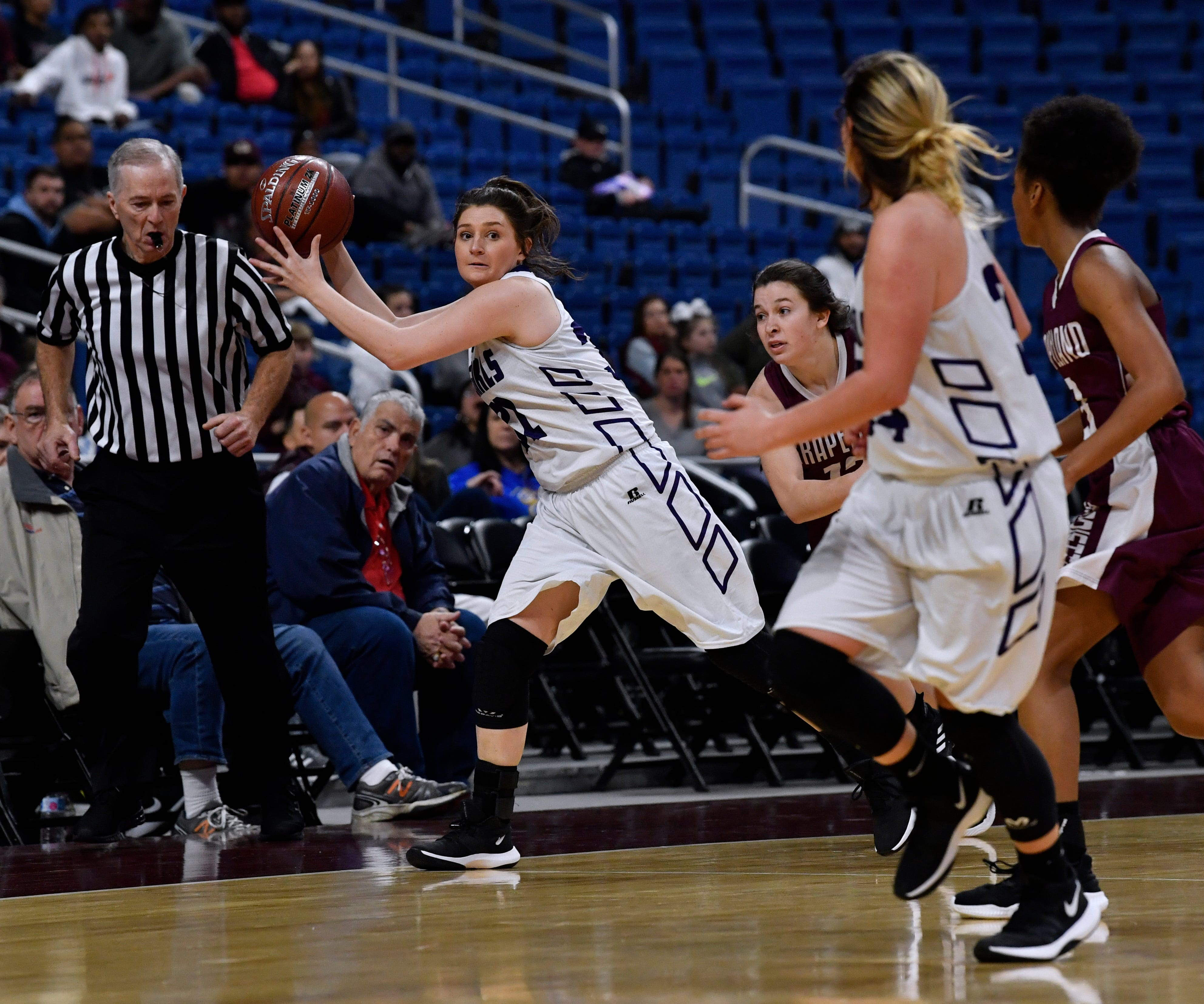 Cowgirls forward Tessa Guice looks up to pass the ball to Mason teammate Jesse Armstrong during Friday's UIL Class 2A girls state basketball semifinal against Grapeland at the Alamodome in San Antonio March 1, 2019.