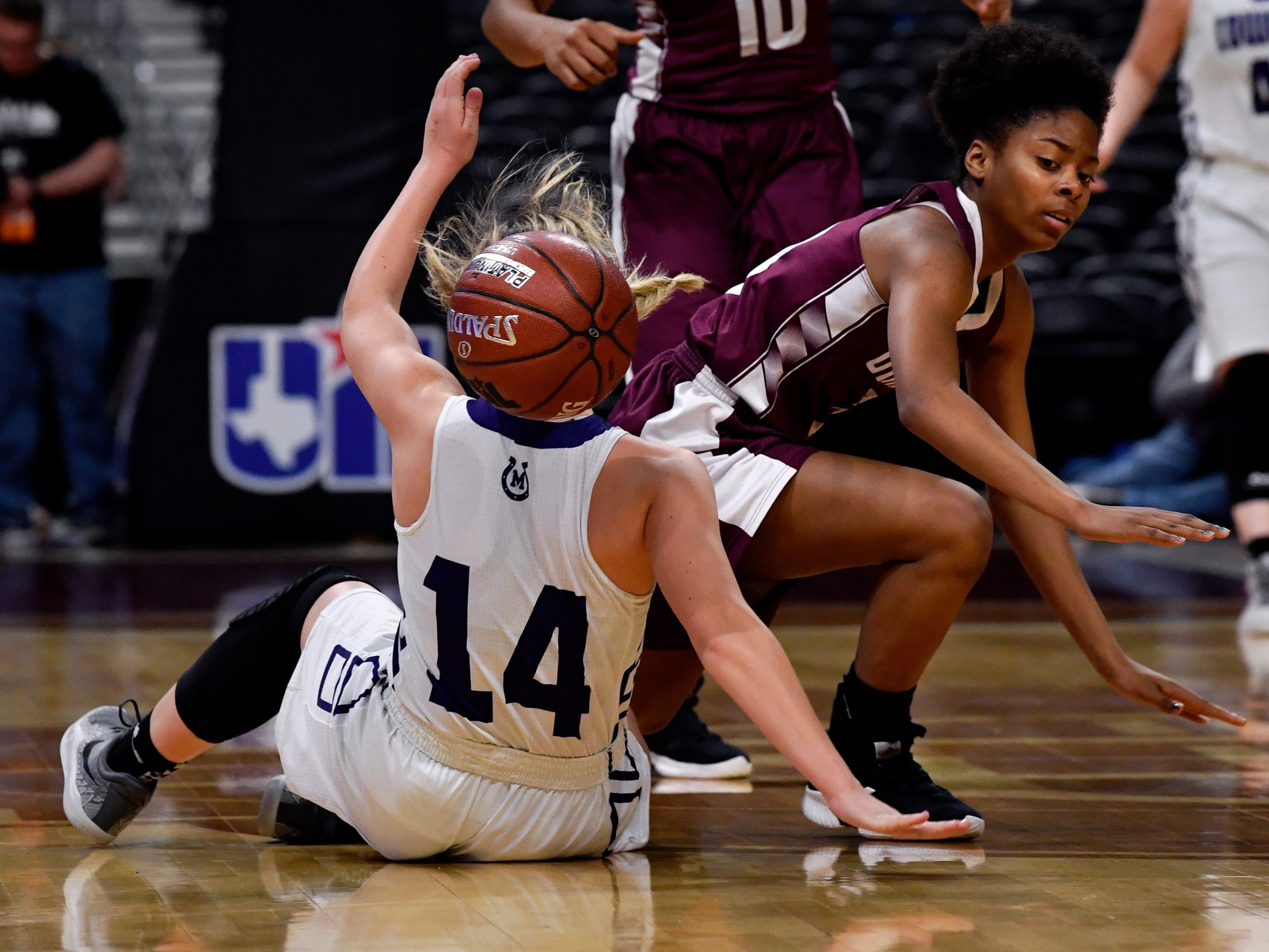 Mason's Presley Anastas is knocked down by Grapeland guard Keaundra Harris during Friday's UIL Class 2A girls state basketball semifinal at the Alamodome in San Antonio March 1, 2019.
