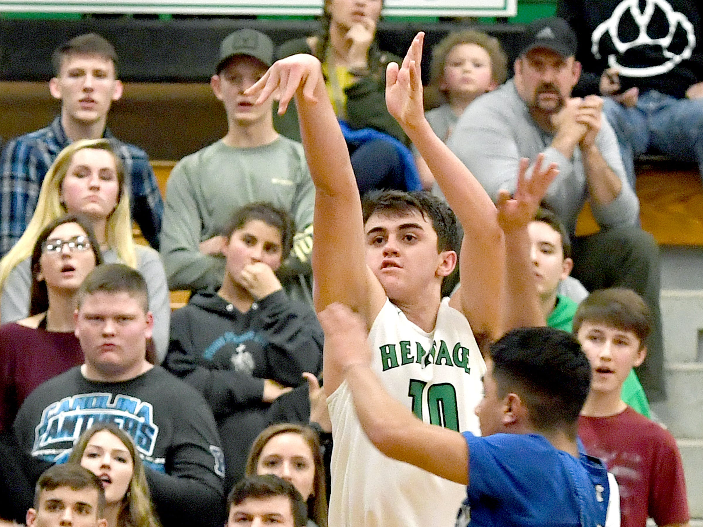 Mountain Heritage's Callin Randolph goes up for a shot from the outside against Maiden during their playoff game at Mountain Heritage High School on Feb. 28, 2019. The Cougars won 74-69 in overtime to advance to the next round.
