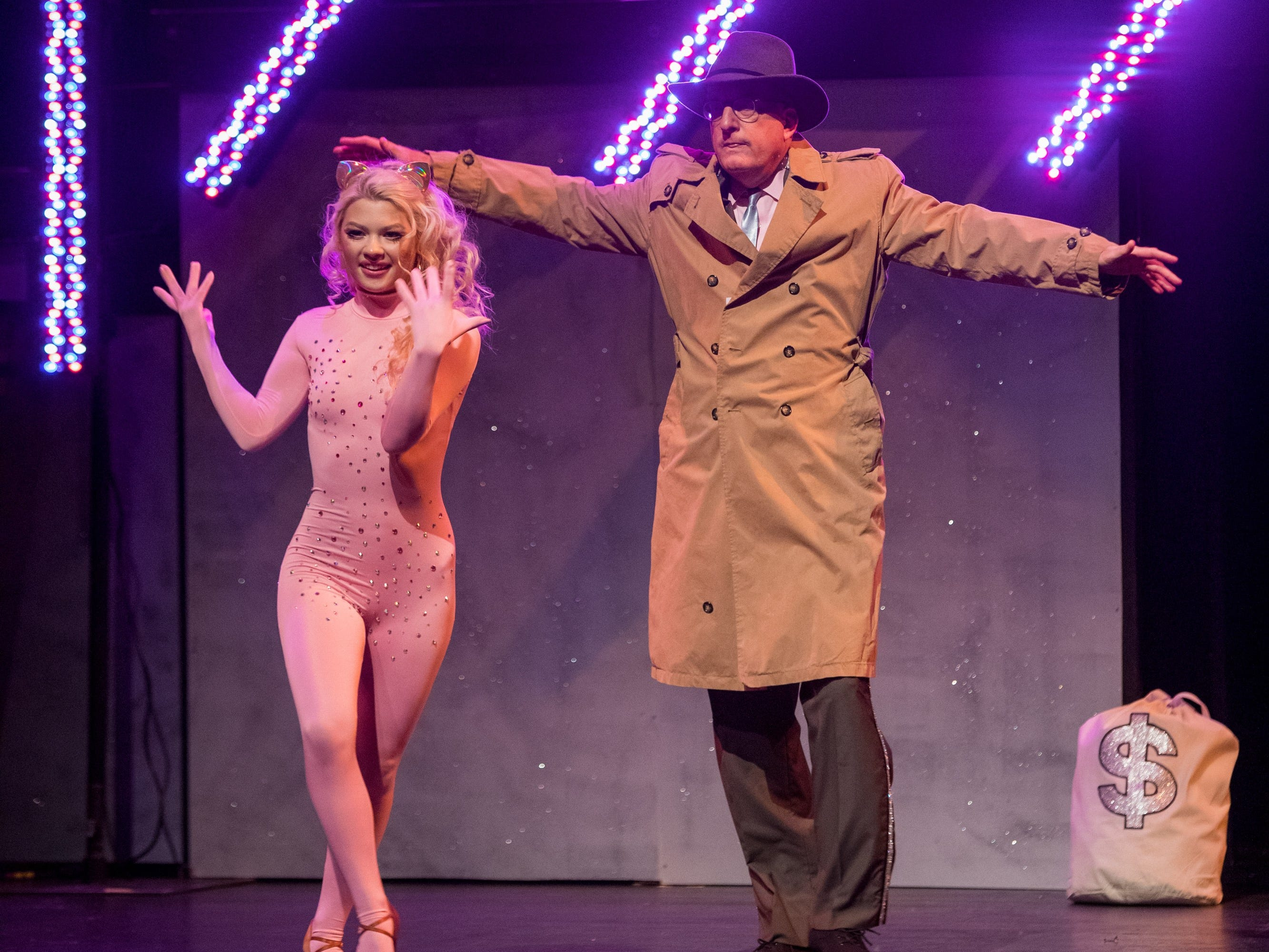 """Charles Frederick, N.C. Market President for TD Bank, and his professional dance partner Miriam Marie, dance to the theme song from """"Pink Panther"""" Feb. 24 at the """"Dancing with the Local Stars"""" fundraiser for the American Cancer Society in Asheville."""