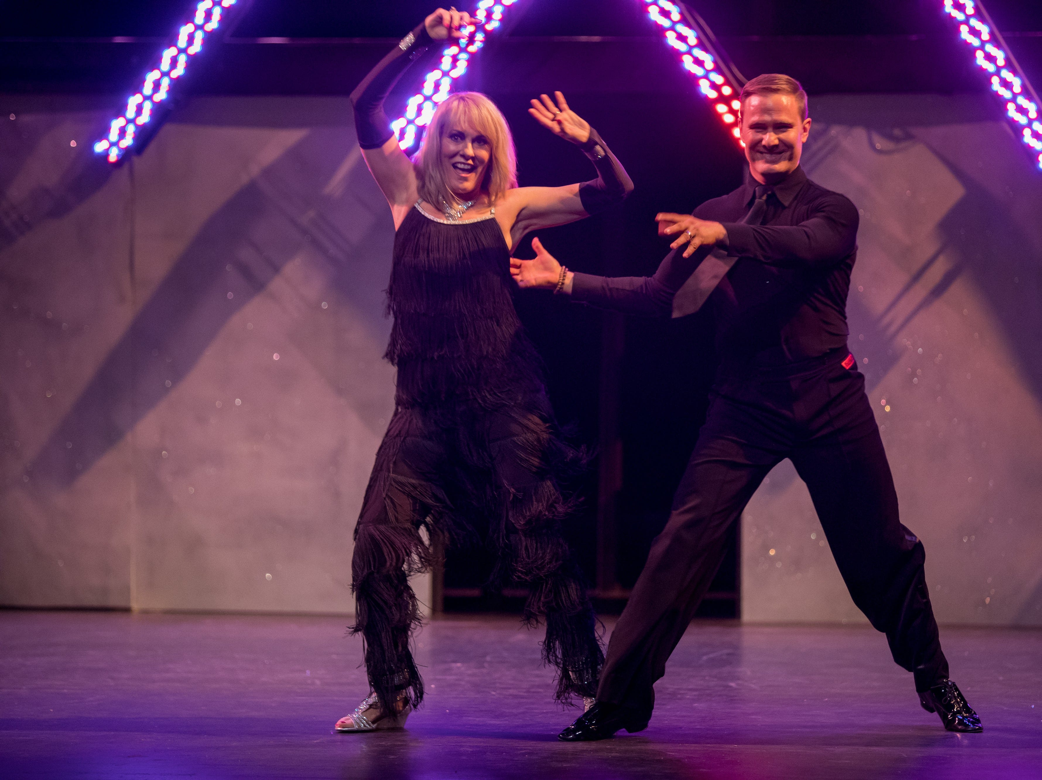 """Tracy Buchanan, CarePartners CEO, and professional dance partner Jake Lavendar dance to the song """"Love Shack,"""" in the Dancing With The Local Stars show Feb. 24, 2019, at Diana Wortham Theatre in Asheville."""