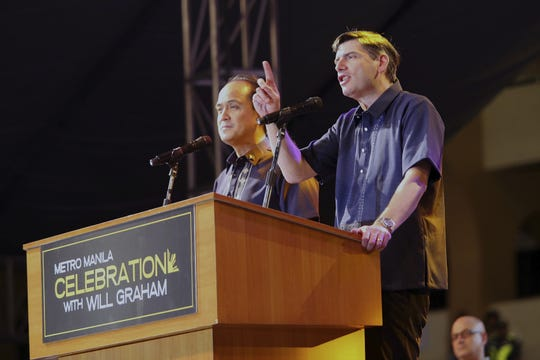 Will Graham, right, the grandson of Billy Graham, has taken on a larger role in the Billy Graham Evangelistic Association, including worldwide preaching engagements. Here he spreads the word in the Philippines.