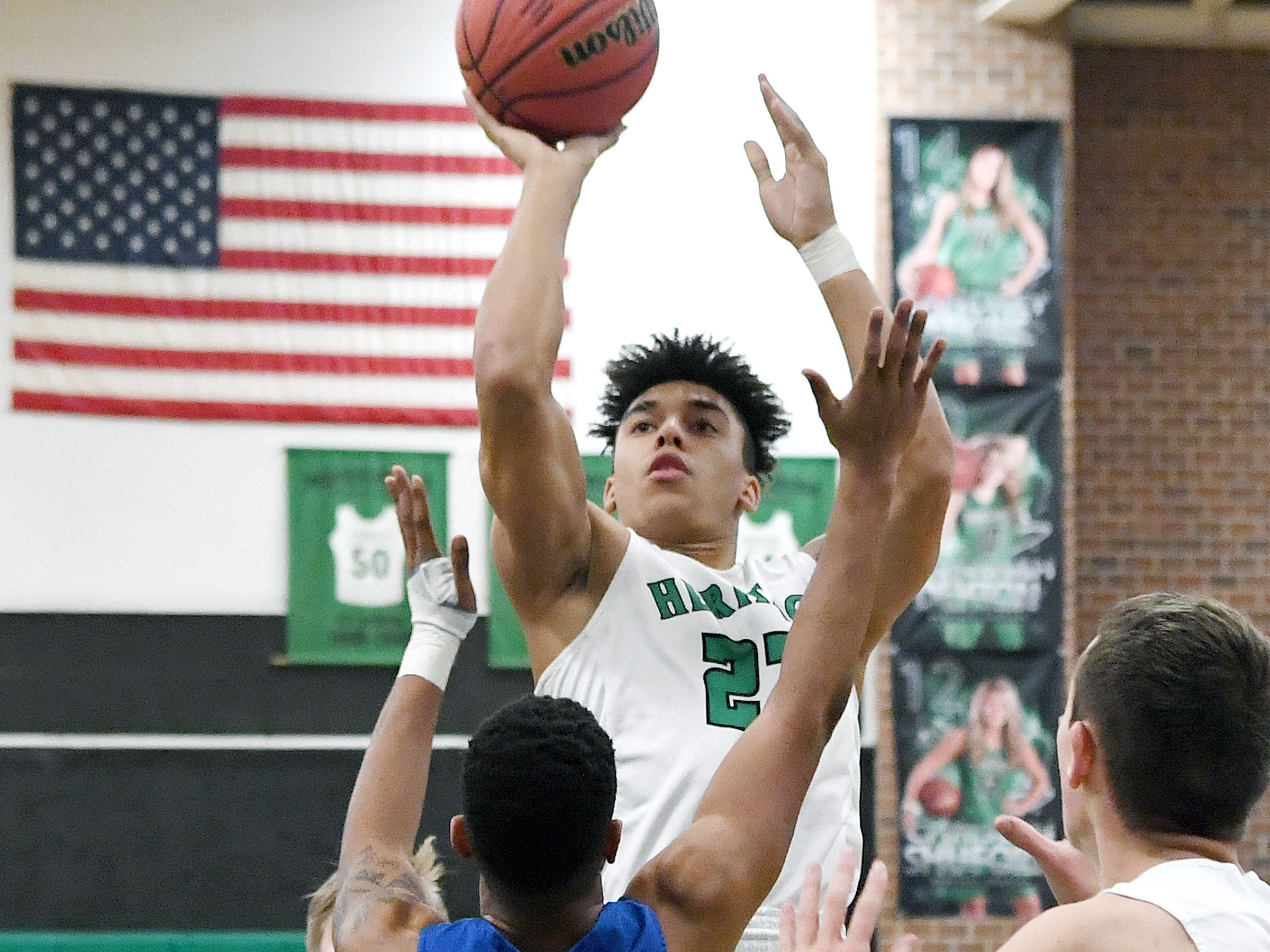 Mountain Heritage's Brandon Aumiller goes up for a shot against Maiden's Montrell Stinson during their playoff game at Mountain Heritage High School on Feb. 28, 2019. The Cougars won 74-69 in overtime to advance to the next round.