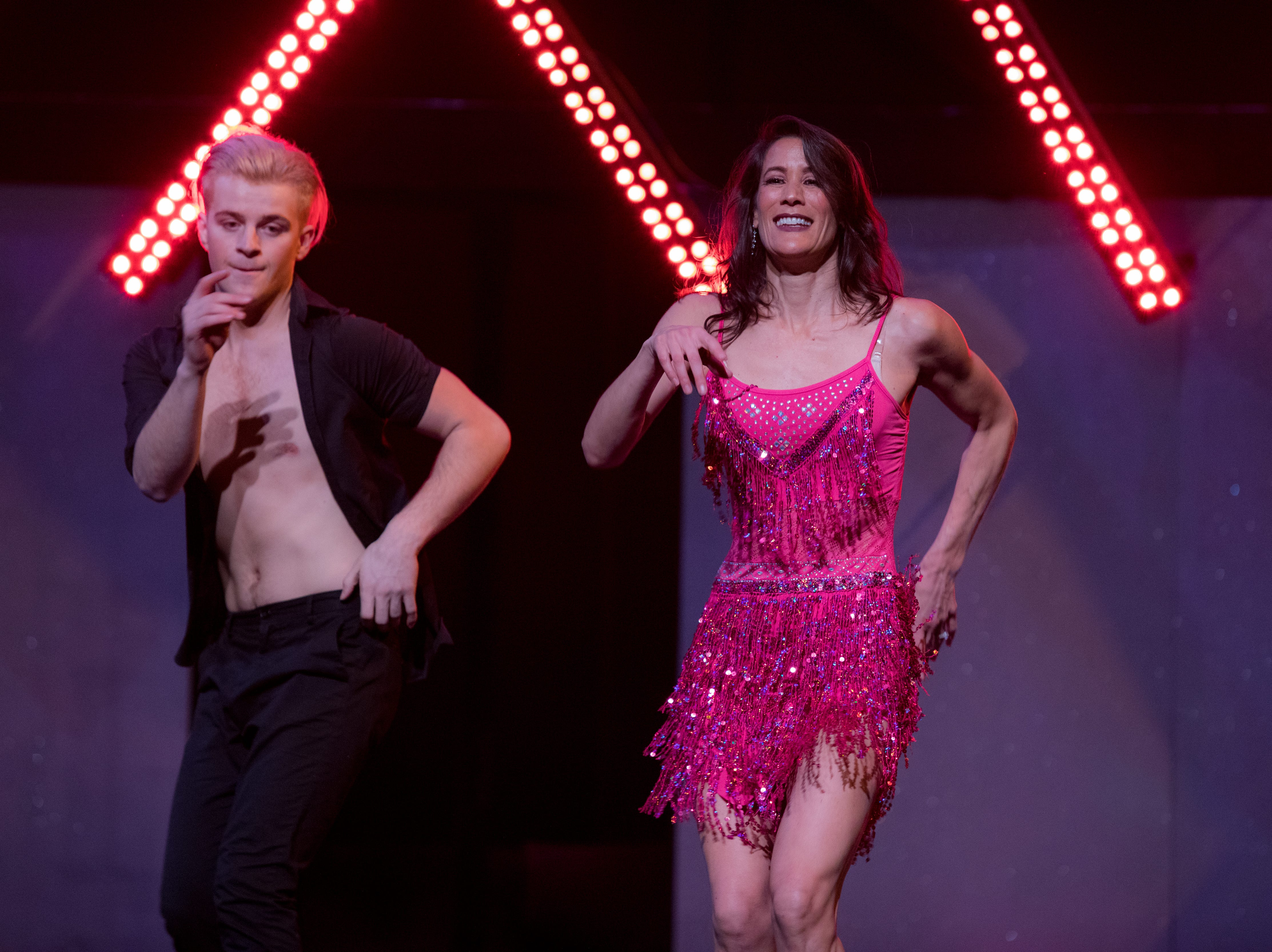 Leah Wong Ashburn, Highland Brewery, with dance partner Travis Stancil, dancing to Dirty Dancing theme song.  At this year's Dancing With The Local Stars at Diane Wortham Theater, February 24th, 2019.  The event raised over 50,000 for ACS.