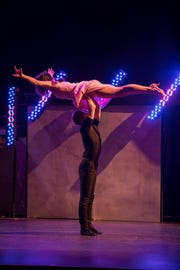 """Travis Stancil lifts Highland Brewing Co. president Leah Ashburn, one of the """"stars"""" of the inaugural """"Dancing with the Local Stars"""" fundraiser for the American Cancer Society Feb. 24 at the Diana Wortham Theatre."""