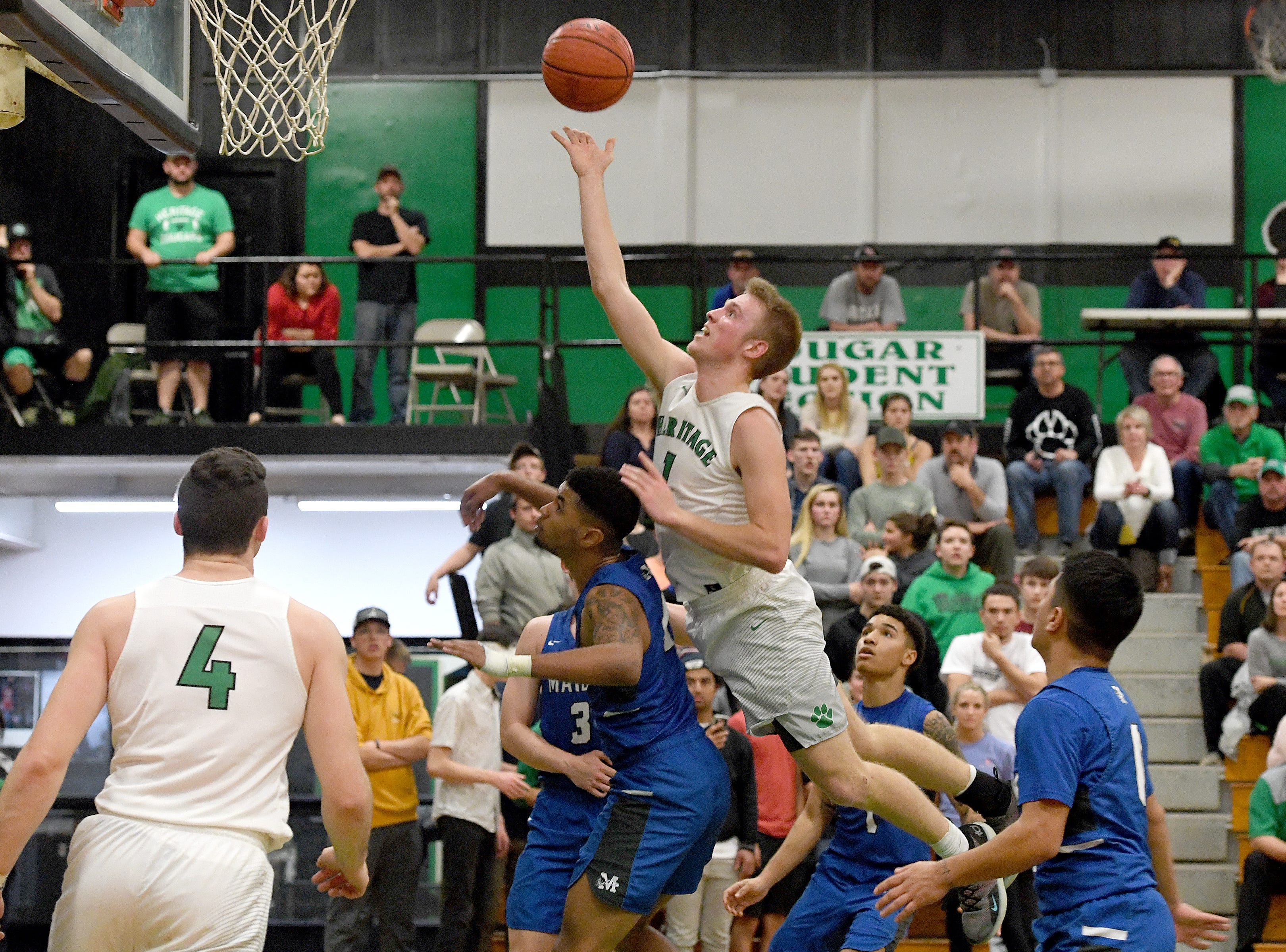 Mountain Heritage's Lucas Jenkins leaps for a shot against Maiden during their playoff game at Mountain Heritage High School on Feb. 28, 2019. The Cougars won 74-69 in overtime to advance to the next round.