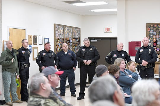 Sheriff deputies and members of the fire department listen to questions and concerns from residents during a community meeting at the Enka Candler Fire and Rescue Department 1 on Feb. 25, 2019.