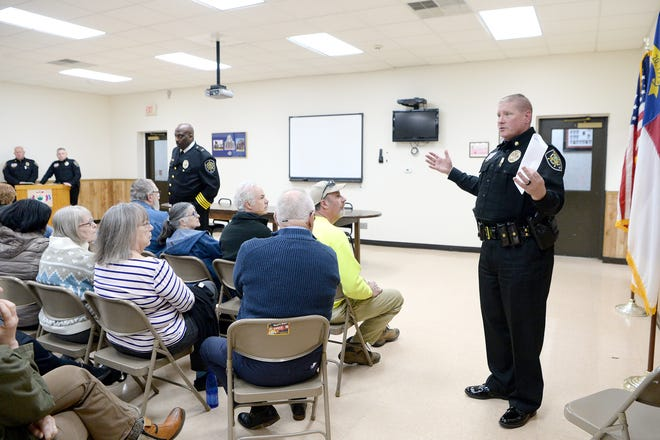 Major Randall Sorrells, with the Buncombe County Sheriff's  office addresses the crowd during a community meeting at the Enka Candler Fire and Rescue Department 1 on Feb. 25, 2019.