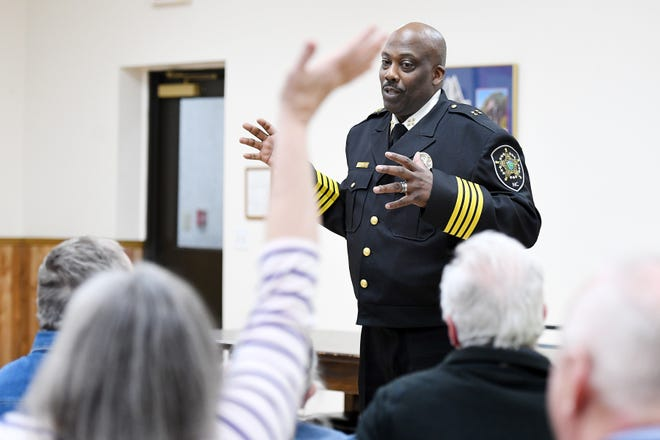 Buncombe County Sheriff Quentin Miller answers questions during a community meeting at the Enka Candler Fire and Rescue Department 1 on Feb. 25, 2019.