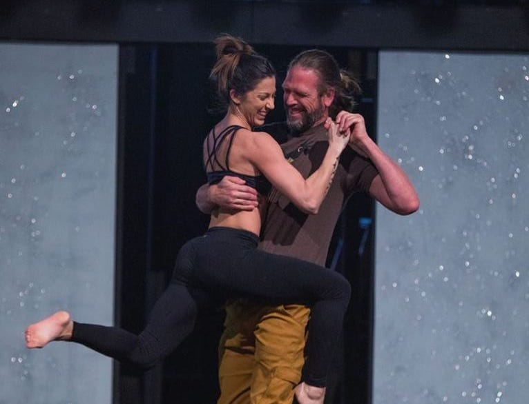 """Kenny Capps, director of the cancer nonprofit Throwing Bones, practices with his partner Sarah Brown backstage before the inaugural """"Dancing with the Local Stars"""" Feb. 24 at the Diana Wortham Theatre in Asheville."""