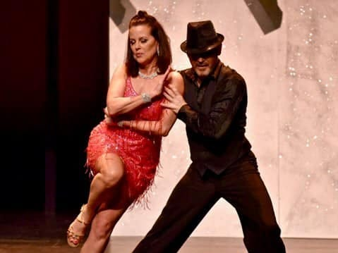 """Laura Webb, president of Webb Investment Services, dances the salsa with Rick Harris at the inaugural """"Dancing with the Local Stars"""" Feb. 24, 2019/"""