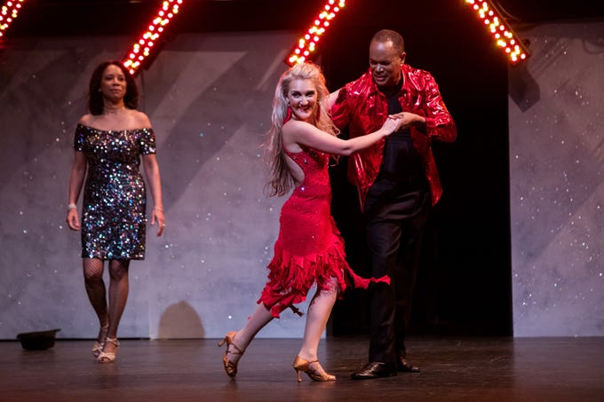 """Robby Russell, PNC Bank commercial relationship manager, dances with pro partner Elena Binder and his wife, Michelle Russell, to the song """"Havana,"""" at the """"Dancing with the Local Stars"""" fundraiser for the American Cancer Society Feb. 24."""