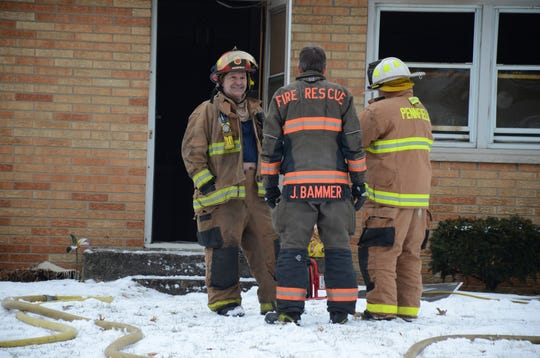 Pennfield firefighters outside the home on Wanondager Trail.