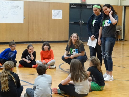 From left, Tioga Central YES Leaders Madalyn Dydynski, Grace Manwaring and Arianna Manwaring talk with Tioga Elementary students about peer pressure and the importance of making good choices at Tioga Central HIgh School during the last school year.