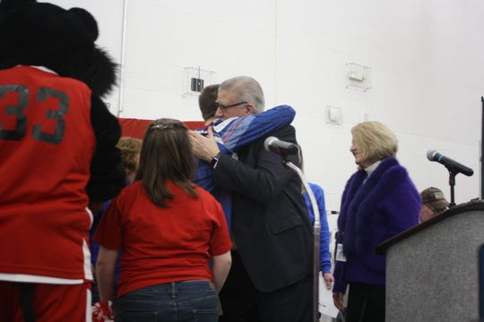 Tioga resident Jared Lamb, a 16-year-old student in Broome-Tioga BOCES' Oak Tree program, hugs BOCES superintendent after a pep rally was held in Jared's honor Friday afternoon.
