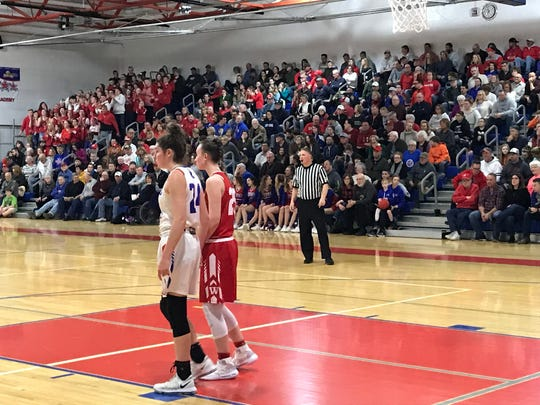 Host Owego and Waverly play before a large crowd Thursday in a Class B semifinal. Owego won, 61-52.