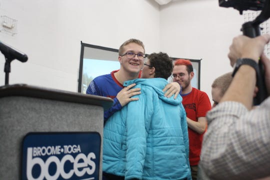 Tioga resident Jared Lamb, a 16-year-old student in Broome-Tioga BOCES' Oak Tree program, hugs his friends after a pep rally was held in Jared's honor Friday afternoon.