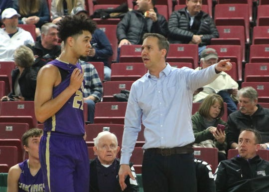 North Kitsap coach Scott Orness talks to Shaa Humphrey during the second half of Friday's Class 2A state tournament game against Fife at the Yakima Valley SunDome.