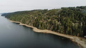 The Navy has purchased a $2.61 million easement on 430 acres that used to be part of the Boy Scouts' Camp Hahobas in Tahuya, paving the way for the Great Peninsula Conservancy and the Department of Natural Resources to purchase the actual land.