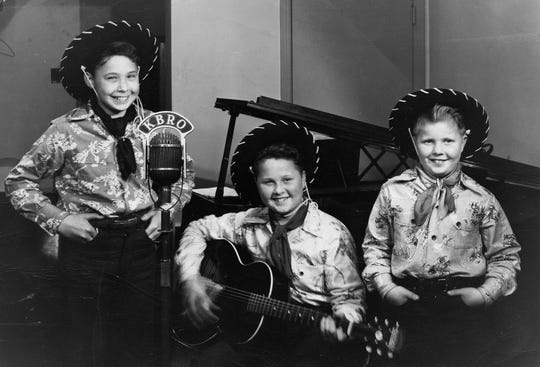 """Performing at the microphone of Bremerton radio station KBRO are the Noll Brothers: Glen, 14, and twins Carl and Harvey, 12. The image of the boys, titled  """"Western Trio,"""" was the lead photo in the Bremerton Eagles Aerie 192 newsletter for June, 1949. To see more photos from the Kitsap County Historical Society Museum archives, visit facebook.com/kitsaphistory, kitsapmuseum.org, or stop by the museum at 280 Fourth St. in Bremerton. Call 360-479-6226 for information."""